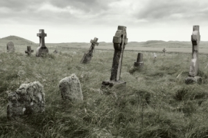 Ancient Celtic gravesite with unmarked gravestones from the 1600's in the middle of a meadow in rural Scotland.