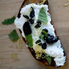 Ricotta Crostini with Black Olives, Lemon Zest & Mint Photo:   André Baranowski for Saveur