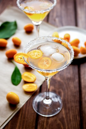 cocktail with kumquat on wooden background